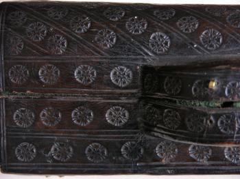 The box is made of leather and elaborately decorated.
