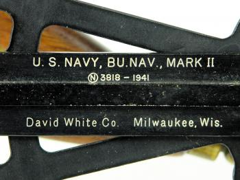 The manufacturer's name and date.