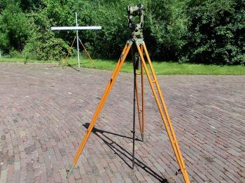 The complete Wild RDH set with original tripod, centring rod and horizontal staff.