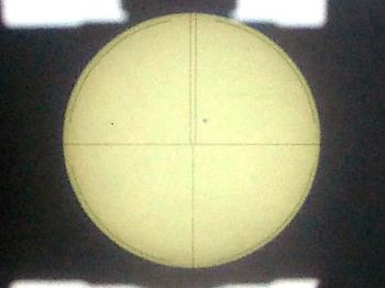 The projected image of the sun and circular reticle of the ABLE-T2.