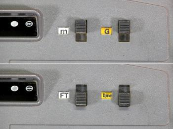 The switches for changing between metres and feet and between gon and degrees.