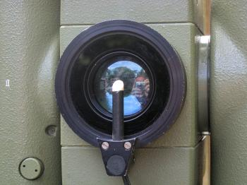 The filter and reticle illumination attachment mounted on the objective.