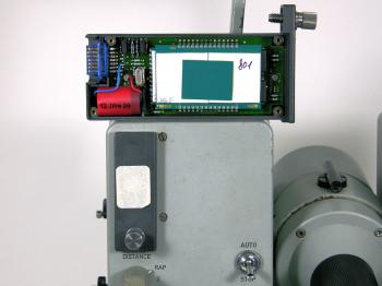 The memory module is inserted at the upper left of the instrument. On top the other module opened.