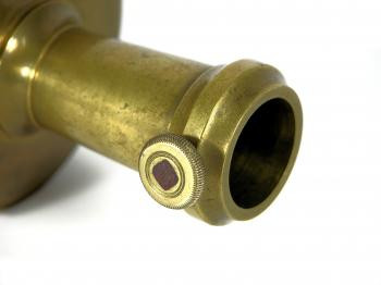 The base can be fixated to a tripod or staff using this brass and steel screw.