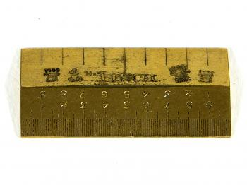 The top side of the Standard Inch with several hallmarks.