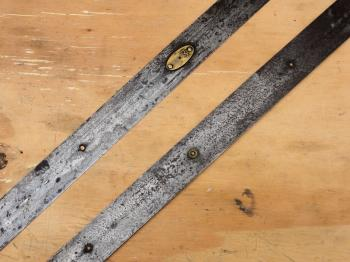 A section of the tape showing the various rivets and a whole metre plate.