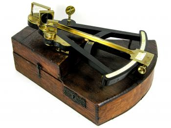The early 19th c. ebony octant on its original key stone box.