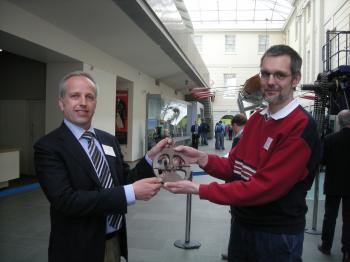 Günther Oestmann (right) handing over the astrolabe copy to me at the NMM in Greenwich.