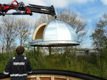 The final piece of the observatory seconds before installation.